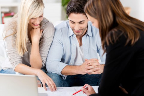 Couple planning mortgage with mortgage broker